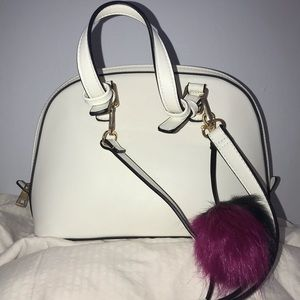 White purse with keychain